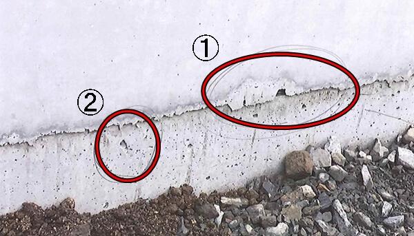 基礎立ち上がり部の水抜き穴と骨材の脱落によるえぐれ